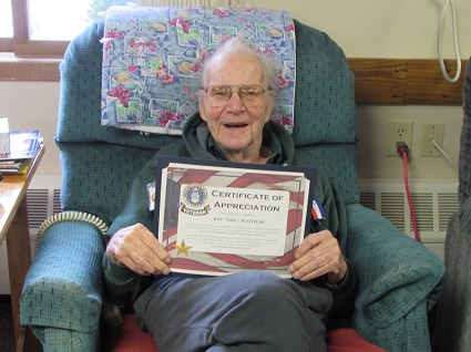 Picture of Roy Ployhar holding his United States Marine Corps Certificate of Appreciation